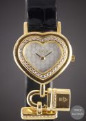 A LADIES 18K SOLID GOLD & DIAMOND CORUM HEART LOCKET WRIST WATCH CIRCA 1990s, REF. 24.181.65 WITH
