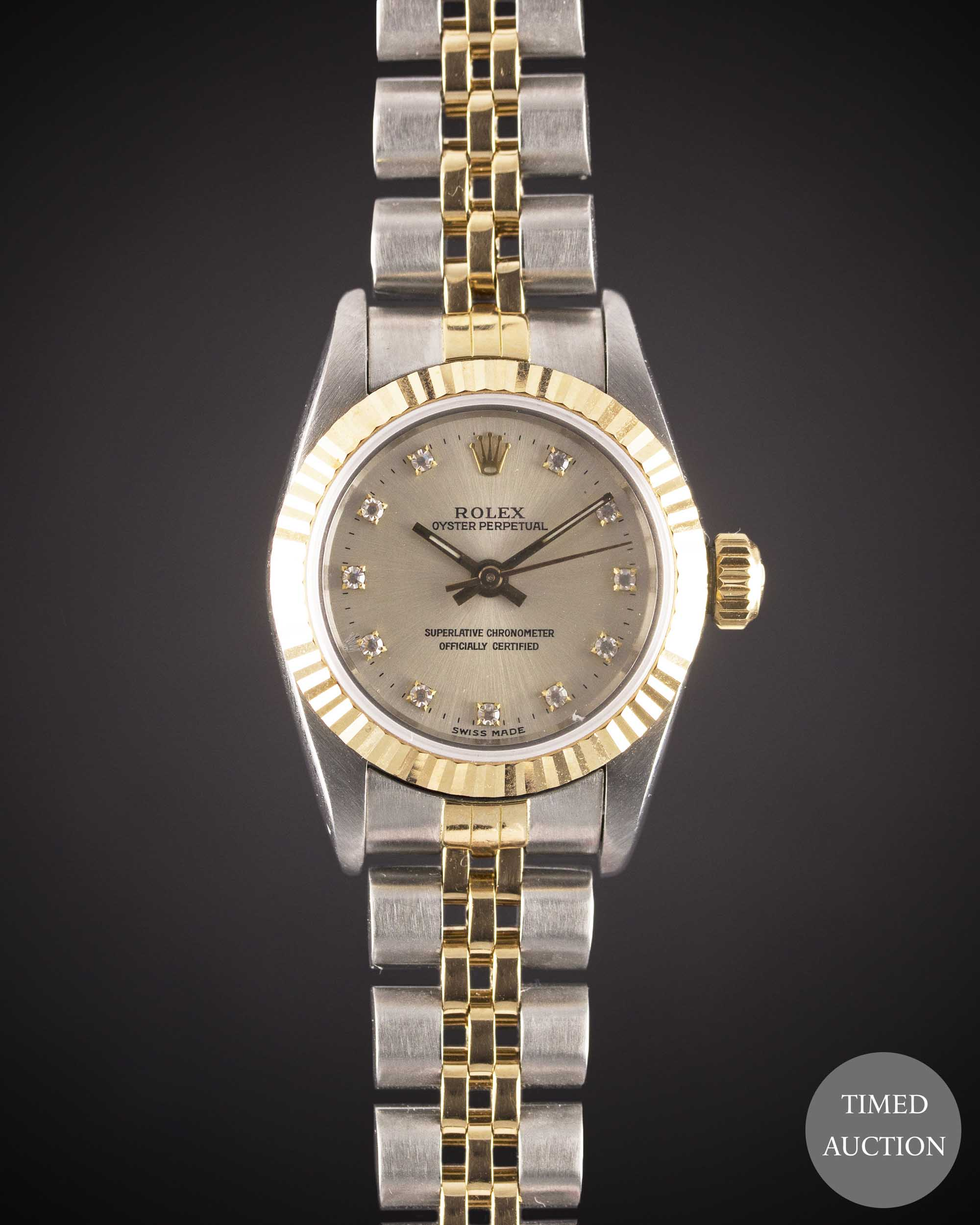 Lot 28 - A LADIES STEEL & GOLD ROLEX OYSTER PERPETUAL BRACELET WATCH CIRCA 1988, REF. 67193 WITH ORIGINAL
