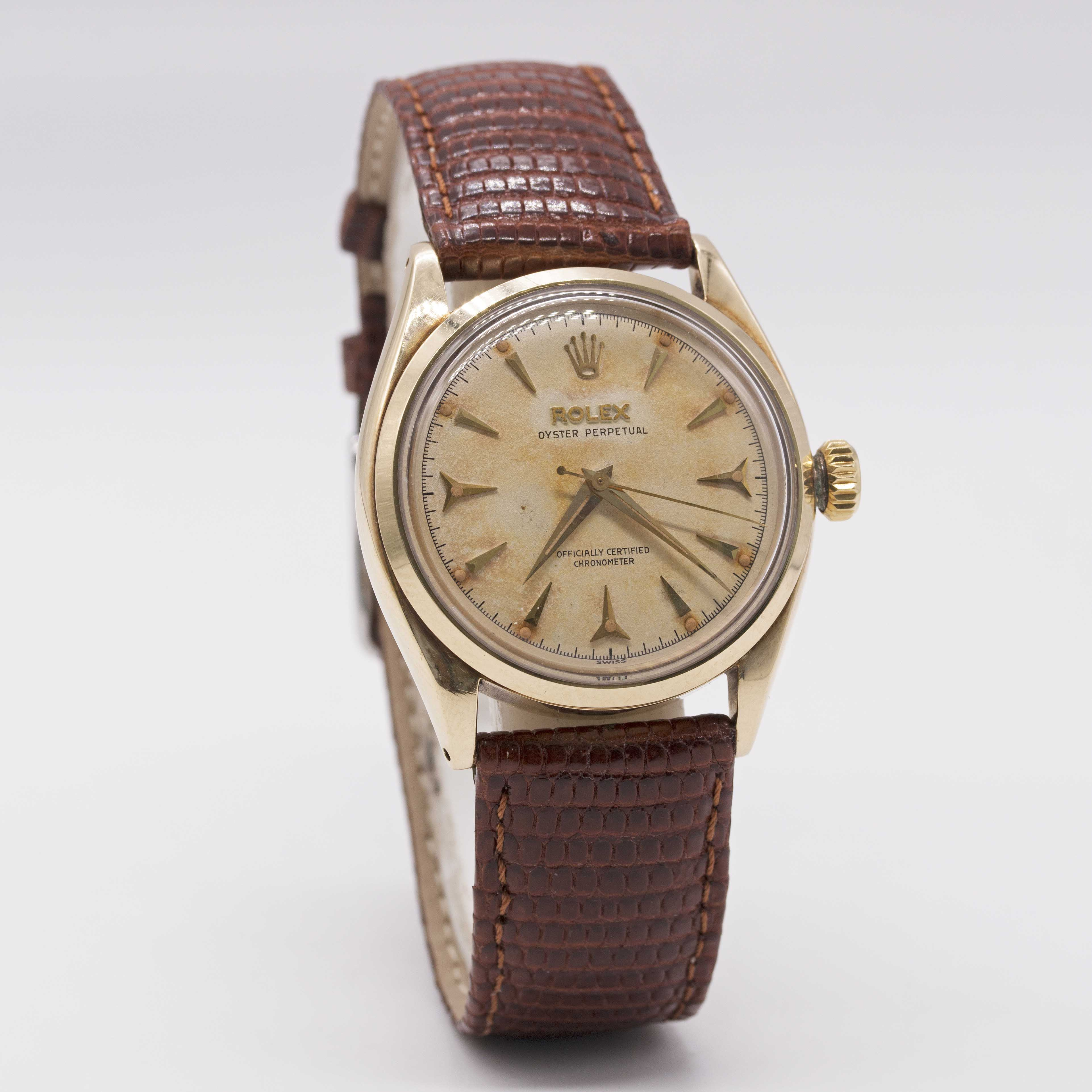 Lot 25 - A GENTLEMAN'S 14K SOLID GOLD ROLEX OYSTER PERPETUAL WRIST WATCH CIRCA 1954, REF. 6584 WITH SILVER ""