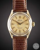 A GENTLEMAN'S 14K SOLID GOLD ROLEX OYSTER PERPETUAL WRIST WATCH CIRCA 1954, REF. 6584 WITH SILVER ""