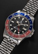 """A GENTLEMAN'S STAINLESS STEEL ROLEX OYSTER PERPETUAL GMT MASTER """"PEPSI"""" BRACELET WATCH CIRCA 1979,"""