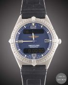 A GENTLEMAN'S TITANIUM BREITLING AEROSPACE MULTIFUNCTION WRIST WATCH CIRCA 1990s, REF. E56060