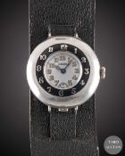A GENTLEMAN'S SOLID SILVER ROLEX HALF HUNTER OFFICERS WRIST WATCH CIRCA 1920, WITH ENAMEL DIAL