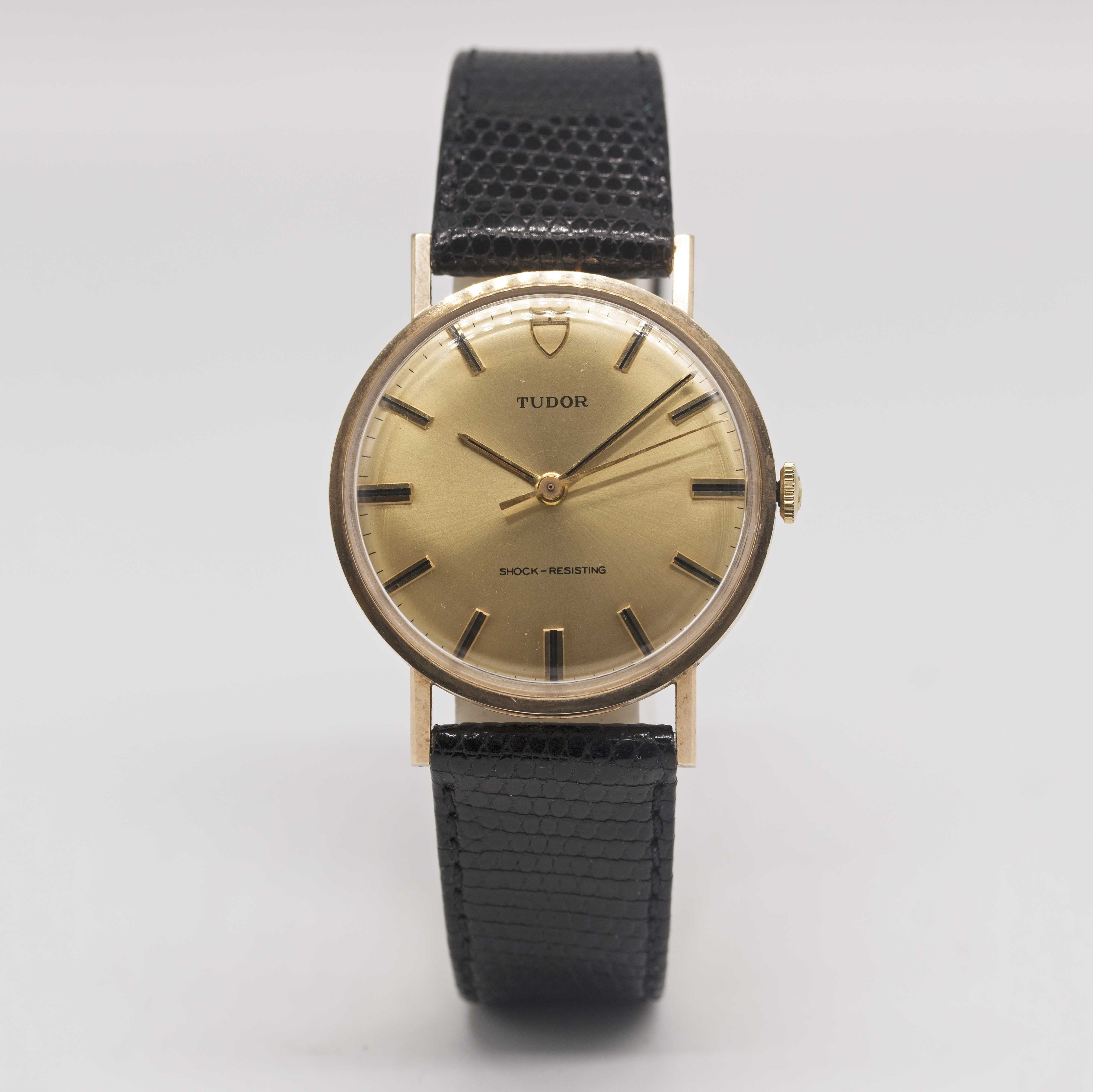 Lot 22 - A GENTLEMAN'S 9CT SOLID GOLD ROLEX TUDOR SHOCK RESISTING WRIST WATCH CIRCA 1969, WITH CHAMPAGNE