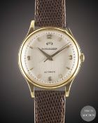 "A GENTLEMAN'S LARGE SIZE 18K SOLID YELLOW GOLD JAEGER LECOULTRE ""POWERMATIC"" POWER RESERVE WRIST"