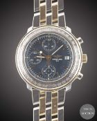 A GENTLEMAN'S STEEL & GOLD BREITLING ASTROMAT LONGITUDE AUTOMATIC CHRONOGRAPH BRACELET WATCH CIRCA