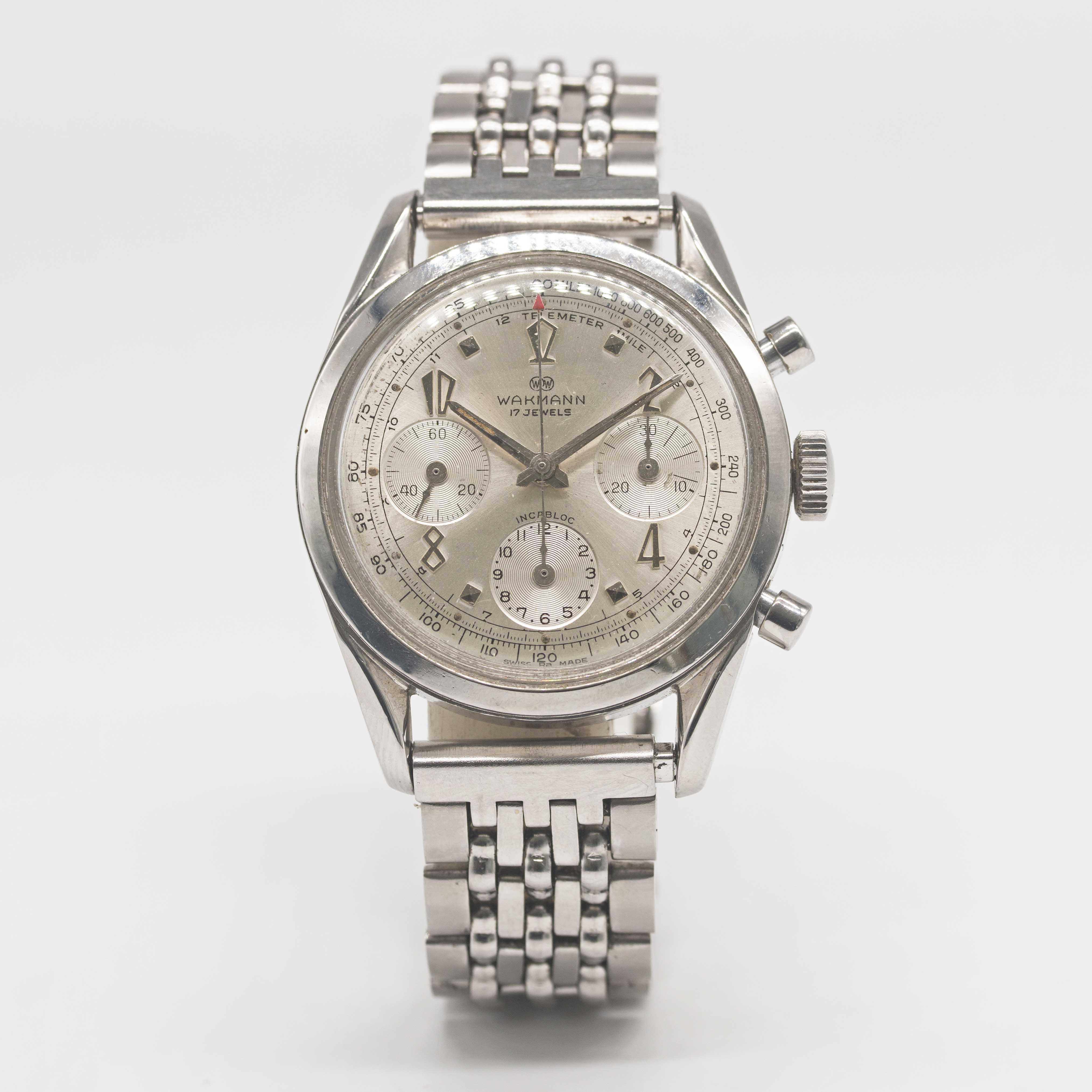 "Lot 29 - A GENTLEMAN'S STAINLESS STEEL WAKMANN CHRONOGRAPH BRACELET WATCH CIRCA 1960s, WITH ""TWISTED"""