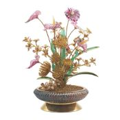 A SILVER GILT, DIAMOND & RUBY SET OBJET D'ART IN THE DESIGN OF A SPRAWLING TROPICAL PLANT CIRCA
