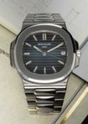 A GENTLEMAN'S STAINLESS STEEL PATEK PHILIPPE NAUTILUS BRACELET WATCH DATED 2009, REF. 5711/1 WITH