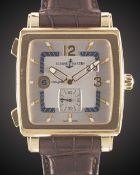 A GENTLEMAN'S 18K SOLID YELLOW GOLD ULYSSE NARDIN QUADRATO DUAL TIME WRIST WATCH CIRCA 2010, REF.