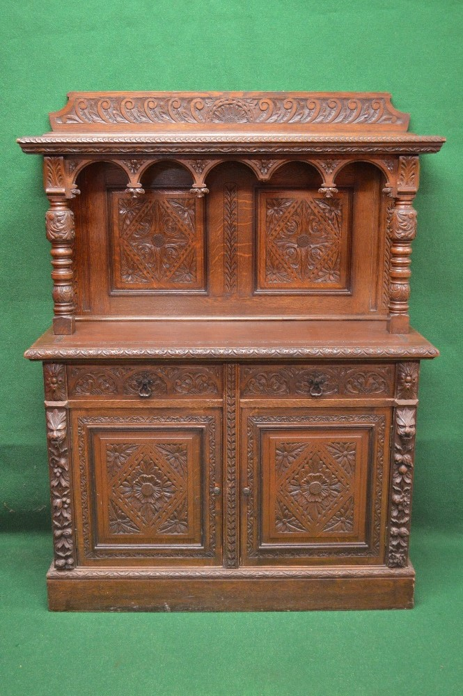 Lot 79 - Victorian oak carved buffet cabinet having carved raised back and shelf supported by turned carved