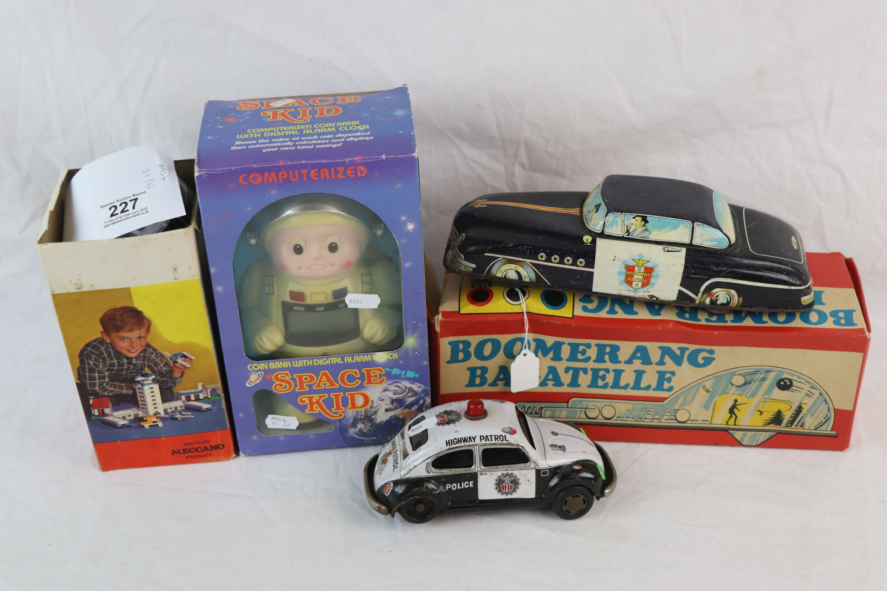 Lot 227 - Boxed Cousins & Hsuehes International Space Kid coin bank with digital alarm clock computerized (box