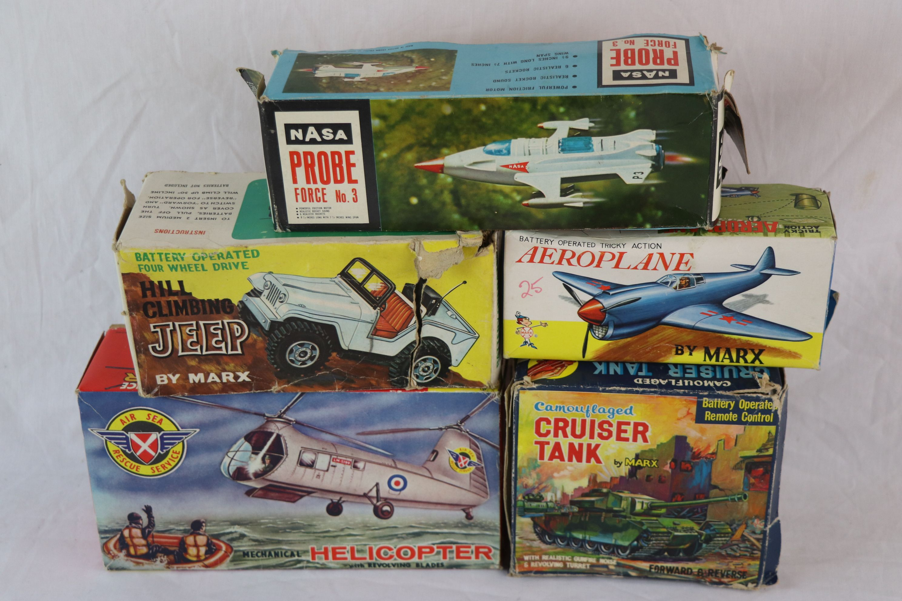 Lot 257 - Five boxed plastic toys, some remote control, to include Marx Hill Climbing Jeep, Marx Camouflaged