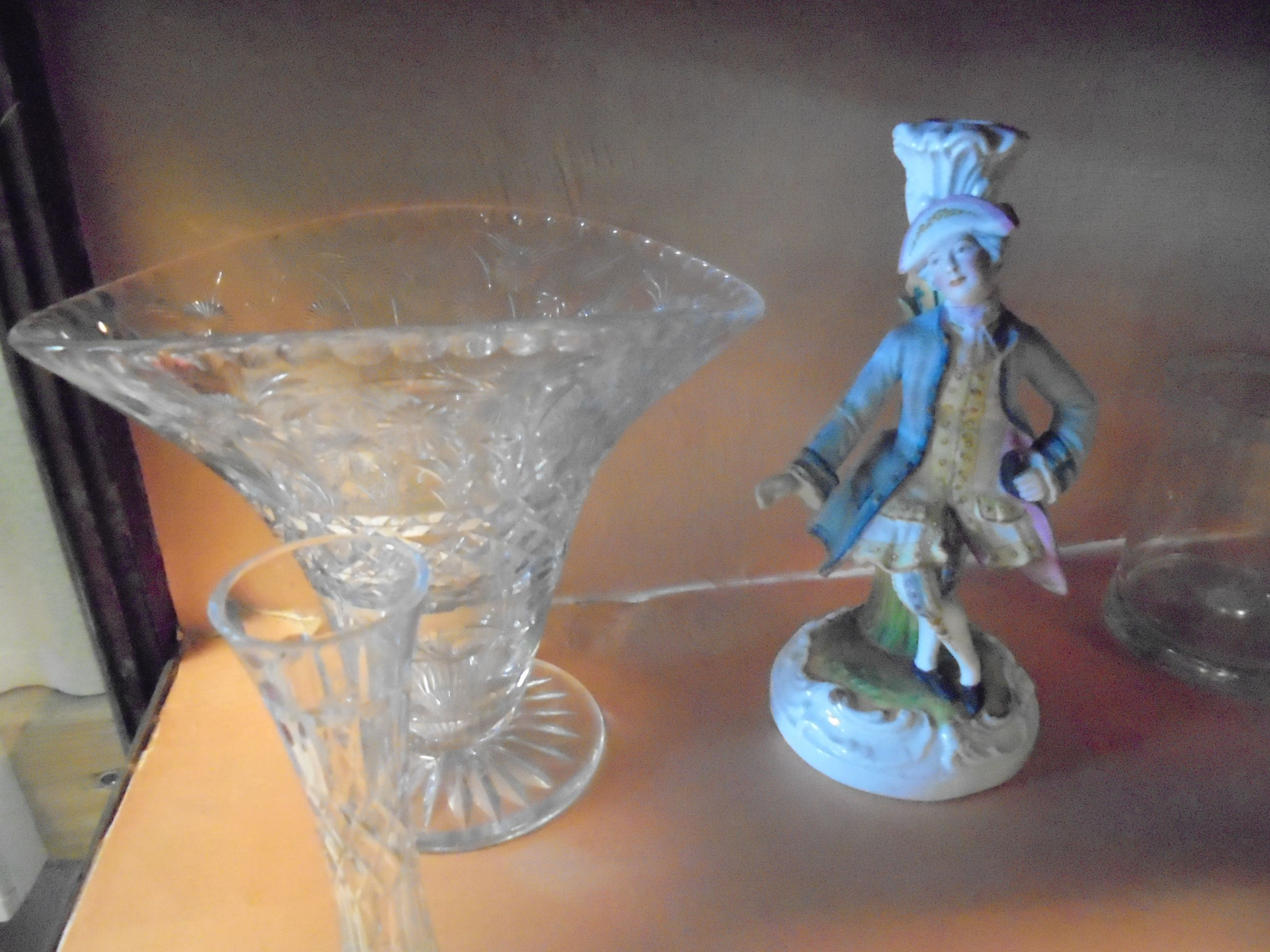 Lot 657 - Three 19th century Continental Porcelain Figures together with a Continental Figure Candlestick,