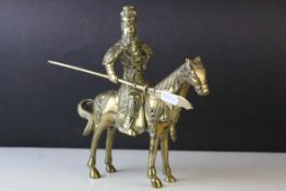 Brass Model of a Chinese Guandi Warrior on Horseback with applied cabochon stones, 23cms high
