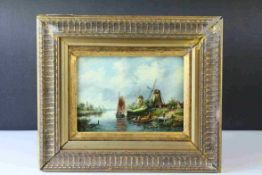 Gilt Framed Oil on Panel of a Dutch River Landscape with Figures in Boats and Windmills beyond