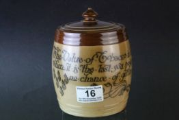 Late 19th Century Doulton Lambeth stoneware salt glazed tobacco jar with the motto `The value of