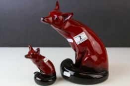 Large Royal Doulton Flambe Seated Fox, 24cms high together with a Smaller Royal Doulton Flambe