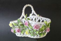 German Von Schierholz Porcelain Pierced Basket decorated with encrusted flowers, 21cms long
