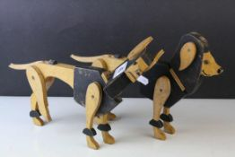Two Wooden Cut-Out Articulated Dog Toys, approx. 31cms long