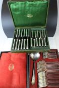 An antique Christofle cased cutlery set spoons and ladle and one other containing knives.