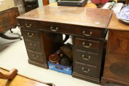 Victorian Mahogany Twin Pedestal Desk, with an arrangement of nine drawers, raised on plinth