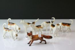 Beswick Fox model 1440 and Seven Beswick Fox Hounds including one model 941, two model 942, two