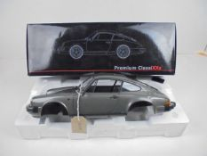 Boxed 1:12 scale limited edition Porsche 911 Carrera 3.2 coupe by Premium Classixxs. Only 500 pieces