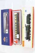 Three boxed OO gauge locomotives to include Bachmann Class 43 Warship D865 Zealous BR maroon