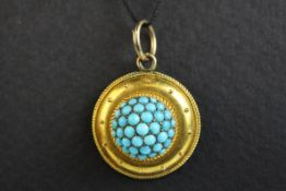 Victorian Etruscan turquoise target pendant, unmarked gold, the centre comprising thrity-seven