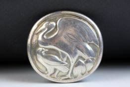 Hugo Lisberg for Georg Jensen; sterling silver circular brooch, modelled as a stork with smaller