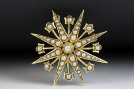 Edwardian seed pearl 15ct yellow gold pendant brooch, eight pronged star full set with graduated