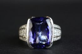 Tanzanite and diamond 18ct white gold ring, the cushion cut tanzanite with certificate stating