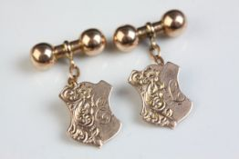 Pair of 9ct rose gold chain link cufflinks, the shield shaped panel with engraved floral and foliate