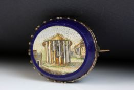 Victorian Grand Tour micro-mosaic oval brooch, the scene depicting a Roman building, yellow metal