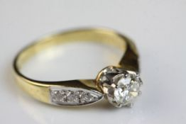 Diamond 18ct yellow gold and white gold set solitaire ring, the principle round brilliant cut