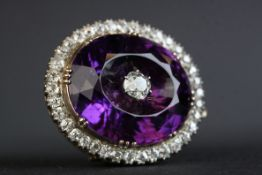 Victorian amethyst and diamond pendant brooch, the large oval faceted amethyst measuring approx 20.