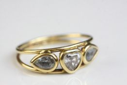 Beryl 18ct yellow gold ring, the goshenite heart shaped central stone with beryl leaf shaped stone