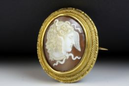 Victorian shell cameo yellow gold brooch depicting Medusa, rub over setting, fancy rope twist and