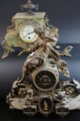 19th century Gilt Metal Mantle Clock surmounted by an Angel, 42cms high together with another Gilt