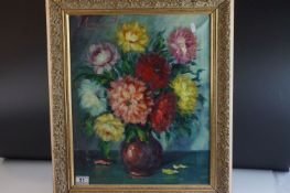 Indistinctly signed still life oil painting of flowers in a vase mounted in a gilt frame