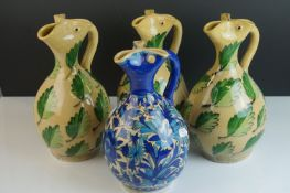 Four Persian Style Hand Thrown and Painted Ceramic Jugs