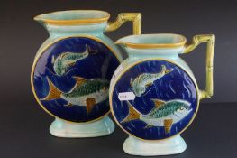 Two matching Victorian Majolica Jugs, tones of blue and green and with relief decoration of fish,