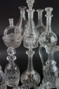 Collection of Nine Decanters and a Claret Jug, some with matched stoppers, together with a