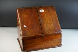 Victorian Oak Stationery Cabinet, the sloping front with two doors opening to reveal a fitted
