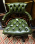 Green leather reproduction button backed swivel office chair, est 70-100