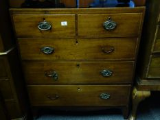 Regency inspired chest of 2 short and 3 graduating long drawers with oval handles and fitted