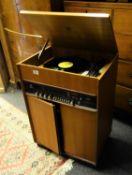 Dynatron, complex stereo system radio hi fi system, on a raised record storage area, teak body,