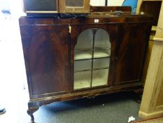 Early 20th century show cabinet with a glazed front centre section flanked by 2 cupboards containing