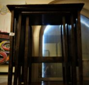 Nest of 3 Arts & Crafts inspired side tables each one with a carved floral top, some re-gluing